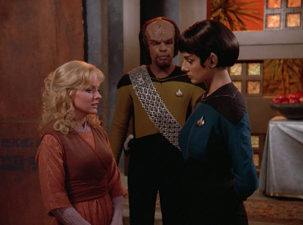 Dr. Selar and Worf talk to Kareen