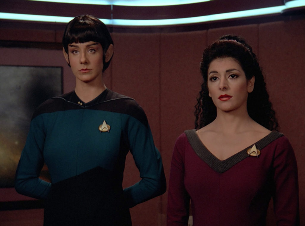 Selar and Troi in Picard's ready room