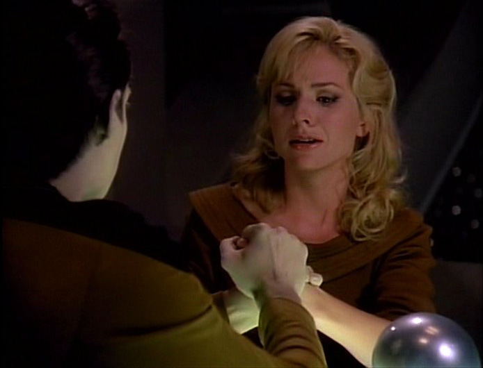 Data grips Kareen's hand so tightly it hurts